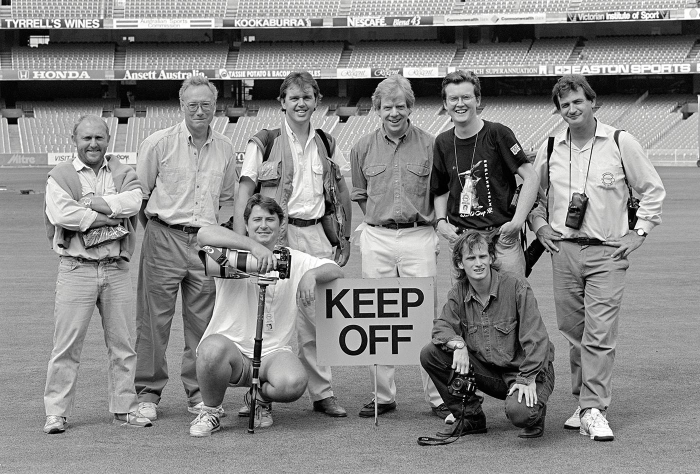 Cricket photographers (standing, from left) Joe Mann, Patrick Eagar, Graham Morris, Brendan Monks, Tom Jenkins, Adrian Murrell, (front row) Ben Radford and Graham Chadwick before the World Cup final at the MCG