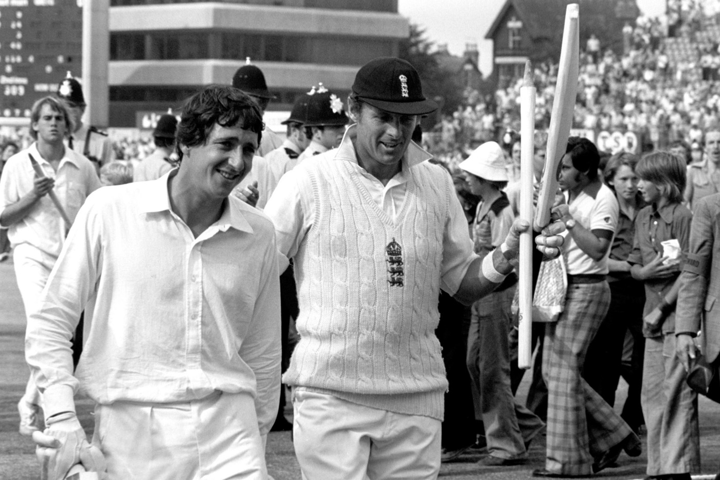 All's well that ends well: having run Derek Randall out in the first innings, Geoff Boycott (right) walks off with him after England win the Test