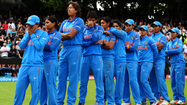 Indian players look on after the final