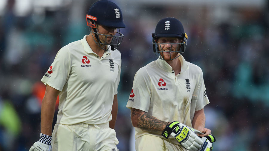 Alastair Cook and Ben Stokes head off as the rain falls