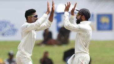Ravindra Jadeja and Virat Kohli celebrate the wicket of Angelo Mathews