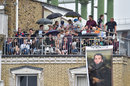 Roof with a view: fans watch on from a neighbouring flat before the rain, England v South Africa, 3rd Investec Test, The Oval, 3rd day, July 29, 2017