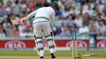 Heino Kuhn has his off-stump flattened by Stuart Broad