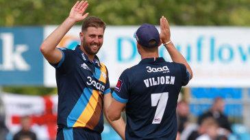 Ben Cotton celebrates a wicket