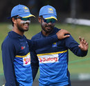 Dinesh Chandimal and Upul Tharanga share a light moment during a nets session