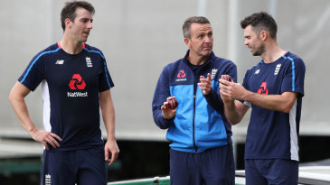 Toby Roland-Jones and James Anderson gets some tips from Dominic Cork