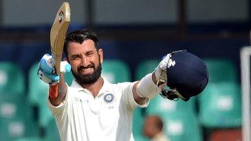 Cheteshwar Pujara beams after reaching his third century against Sri Lanka