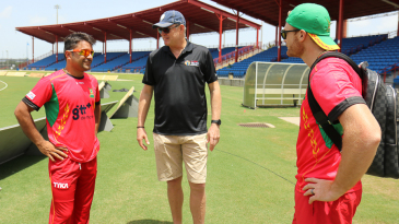 Rashid Khan, Tom Moody and Martin Guptill have a friendly chat at Amazon Warriors training