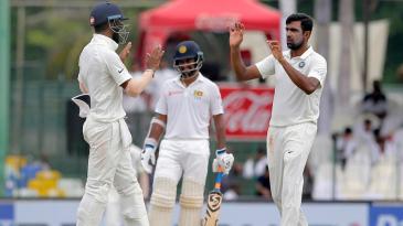 R Ashwin celebrates the wicket of Malinda Pushpakumara with KL Rahul