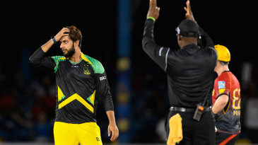 Imad Wasim looks on after being hit for six
