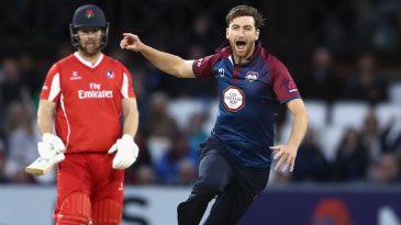 Richard Gleeson wheels away in delight after bowling Jos Buttler