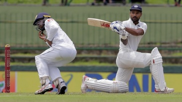 Kusal Mendis ducks in time to evade a Shikhar Dhawan force