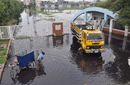 A truck and a delivery cycle are being washed with the contaminated water in front of the Fatullah Cricket Stadium's main gate, Fatullah, August 7