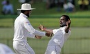 Dinesh Chandimal and Malinda Pushpakumara celebrate a wicket, Sri Lanka v India, 3rd Test, 1st day, Pallekele, August 12, 2017