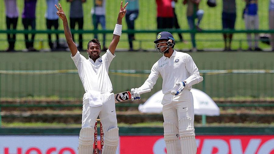 Hardik Pandya, celebrating his first international century, is congratulated by Umesh Yadav