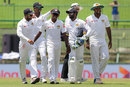 Lakshan Sandakan is congratulated by his team-mates on his maiden five-wicket haul, Sri Lanka v India, 3rd Test, 2nd day, Pallekele, August 13, 2017