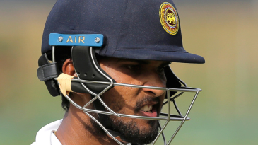 Dinesh Chandimal reacts on his way back to the pavilion after falling for 48