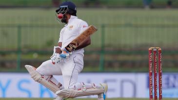 Dimuth Karunaratne tries to evade a bouncer