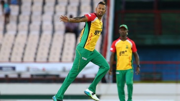 Rayad Emrit celebrates the wicket of Marlon Samuels