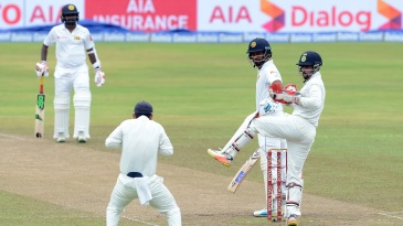 Dimuth Karunaratne watches his outside edge pouched by slip