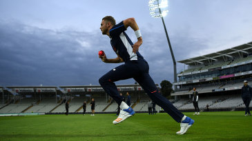 Stuart Broad bowls with the pink ball as England train under lights