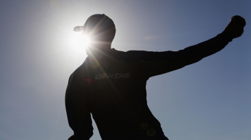 Silhouette of Nathan Lyon as he bowls during a net session