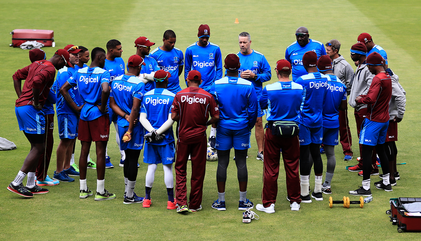 West Indies' head coach Stuart Law gives a team talk