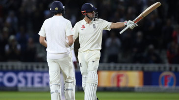 Alastair Cook salutes the crowd on reaching 150
