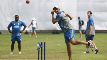 Spin coach S Sriram observes Ashton Agar's bowling during nets