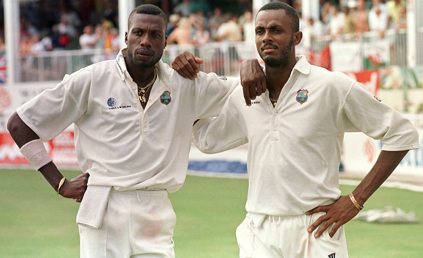 Curtly Ambrose and Courtney Walsh relax after the day's play
