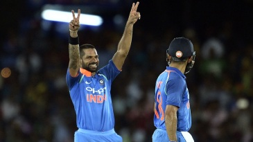 Shikhar Dhawan celebrates his fastest ODI hundred