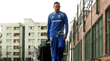 Usman Khawaja walks out of training after a rain interruption