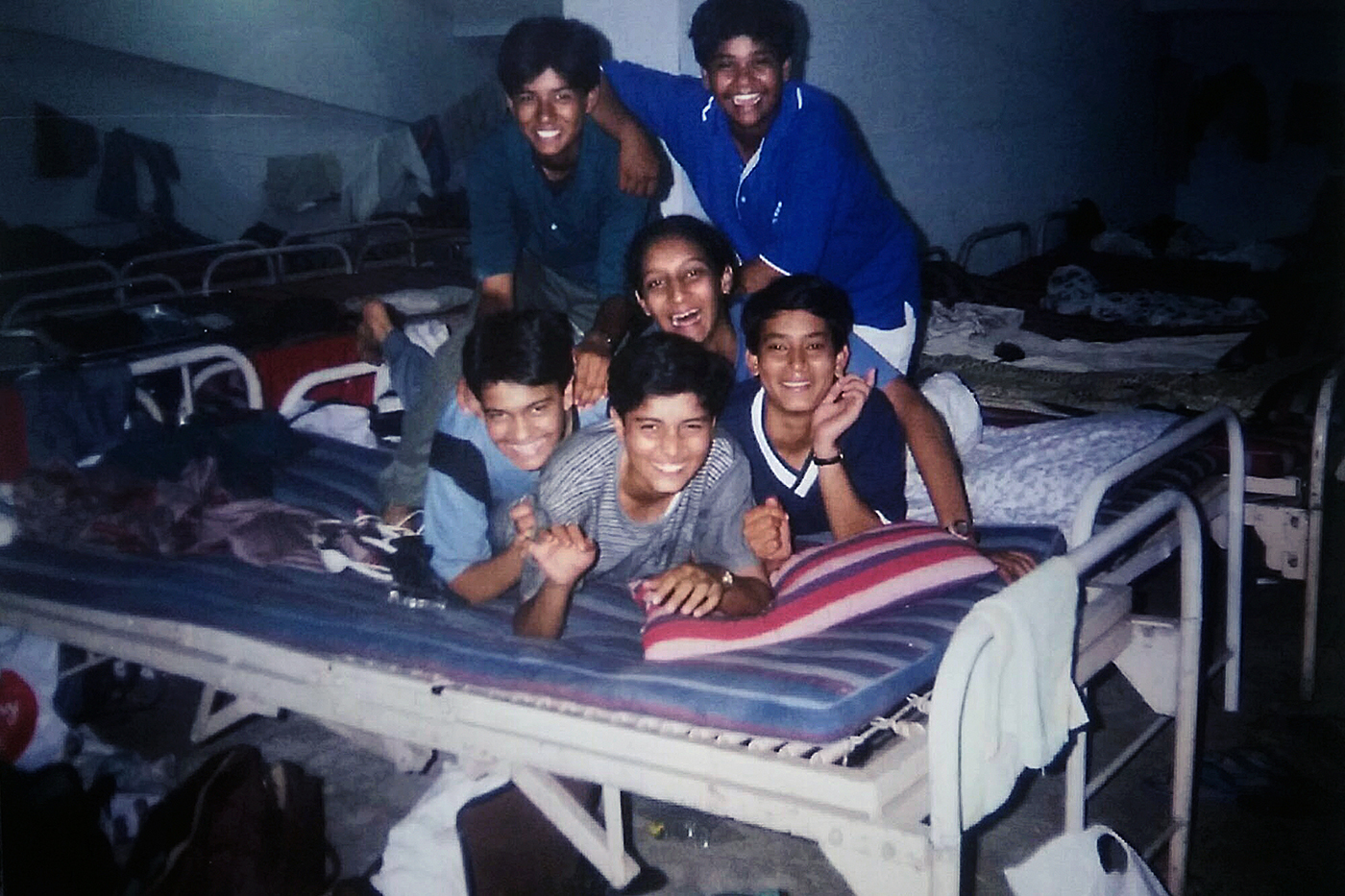 The author (centre) with other junior cricketers in a dormitory during an U-15 tournament in Jamshedpur