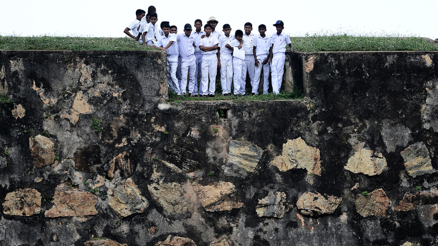 Schoolchildren watch the match from Galle Fort