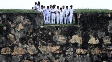 Schoolchildren watch the match from Galle Fort