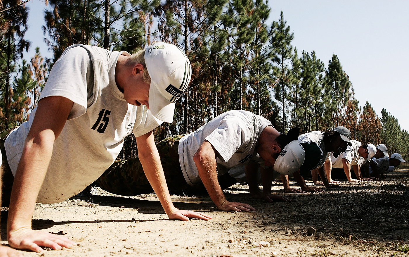 Cullen and the Australian squad do push-ups during a boot camp at the Beerwah State Forest, 2006