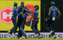 Akila Dananjaya celebrates with his team-mates after snaring his sixth victim, Sri Lanka v India, 2nd ODI, Pallekele, August 24, 2017