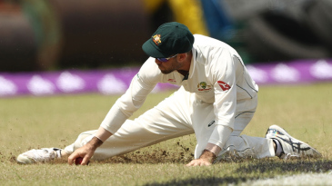 Glenn Maxwell slides in the outfield