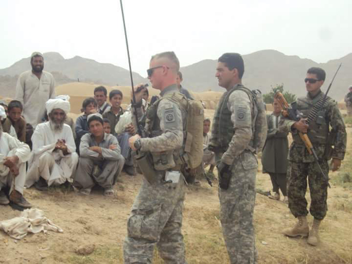 Archi (second soldier from right) at work as a translator for the US forces