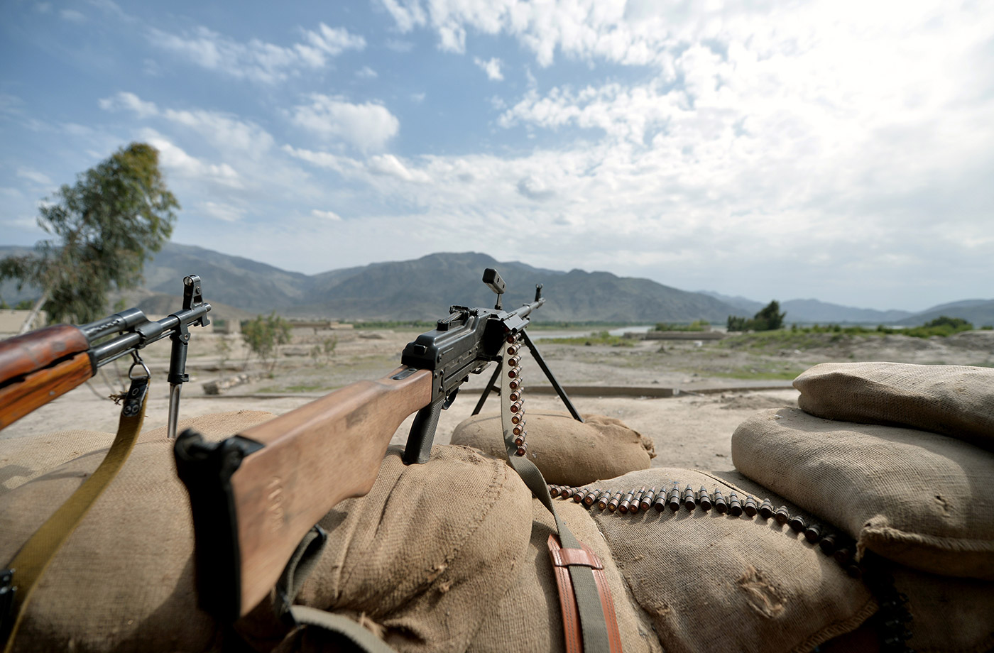 Guns of the Afghan Local Police point towards the Hindu Kush mountains