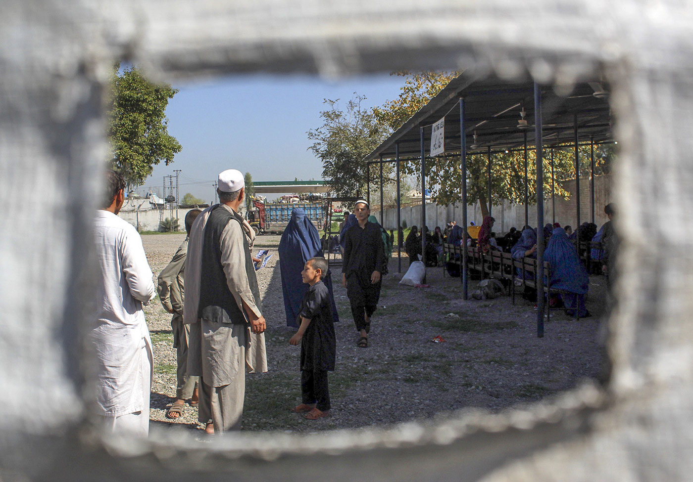 Afghan refugees near the UN High Commissioner for Refugees' office in Peshawar, Pakistan