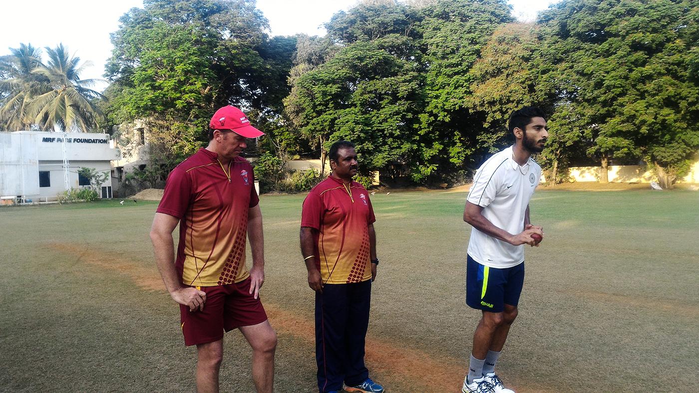 Glenn McGrath and MRF Pace Foundation's chief coach Myluahanan Senthilnathan watch Punjab's Jaskaran Singh bowl