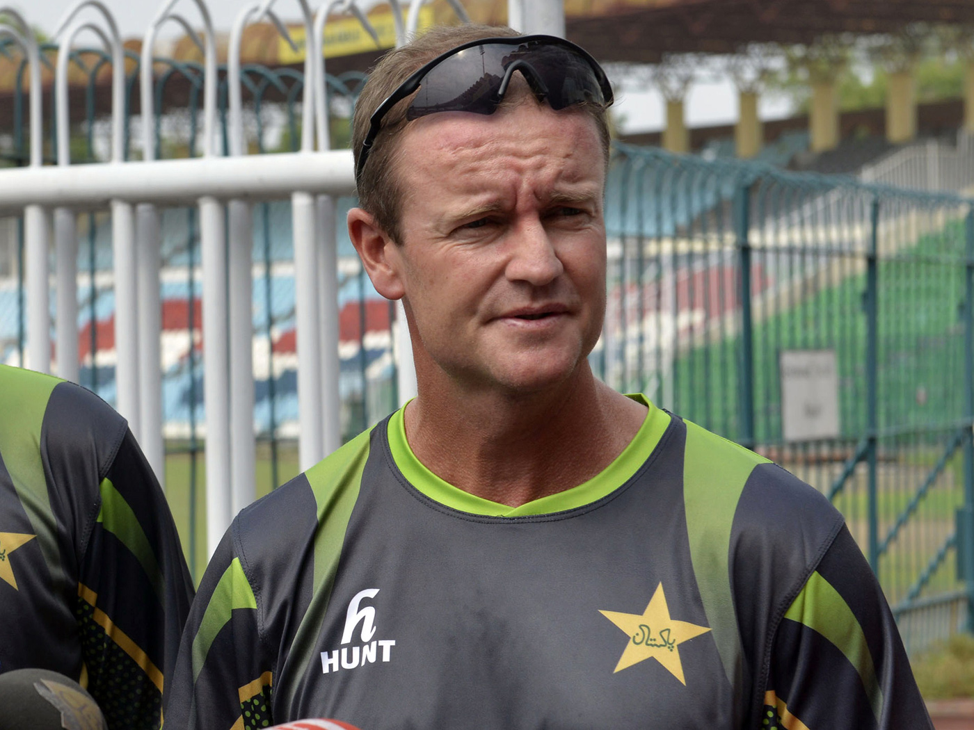 Grant Flower addresses the media in Lahore