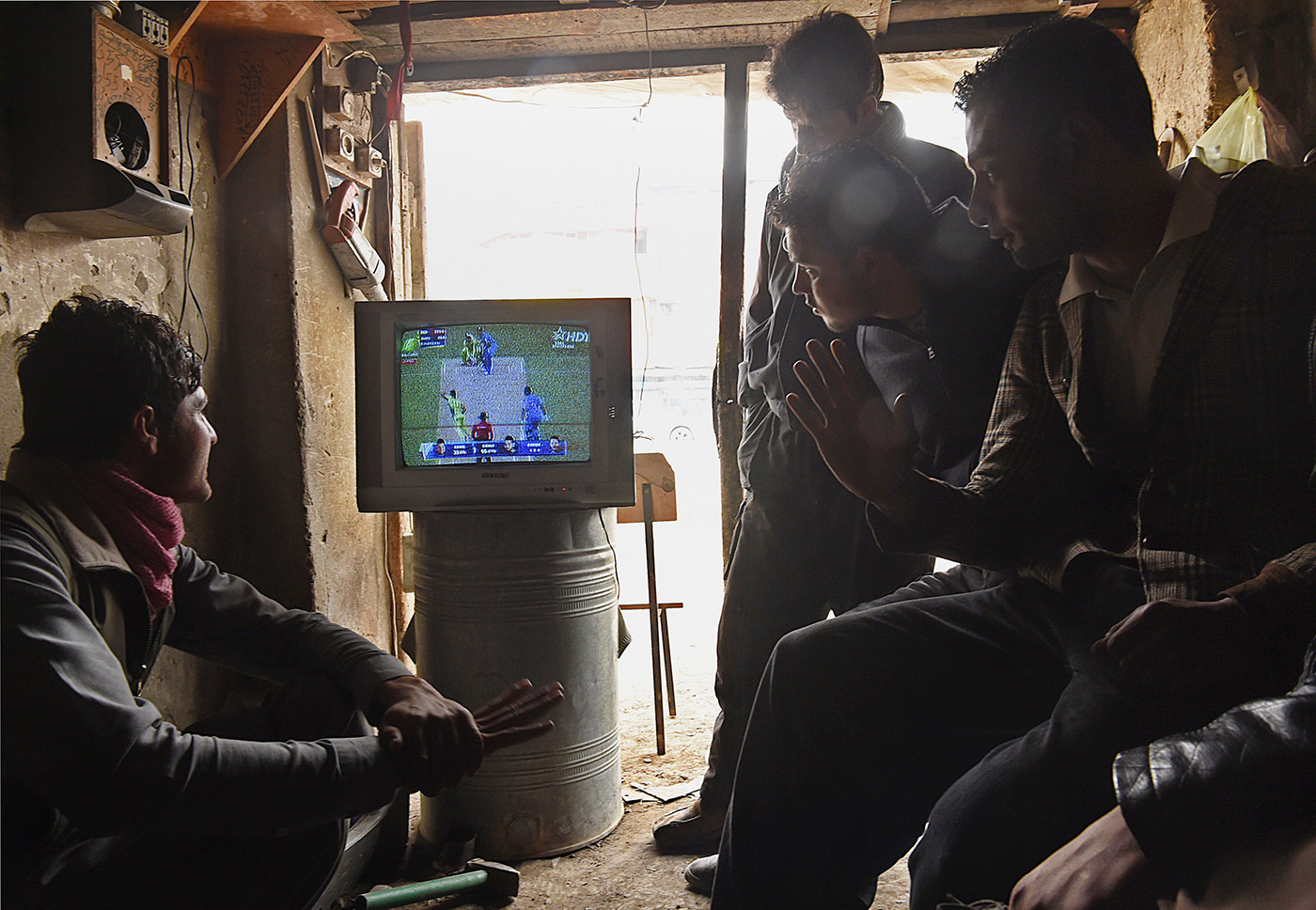 The big ticket: locals watch the India-Pakistan game at the last World Cup in a Kabul shop