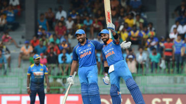 Virat Kohli acknowledges the applause of his mates after bringing up his 29th ODI ton