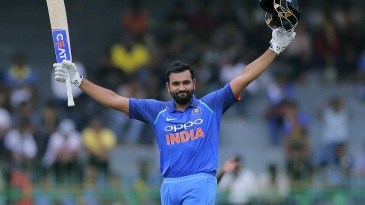 Rohit Sharma celebrates after reaching triple figures
