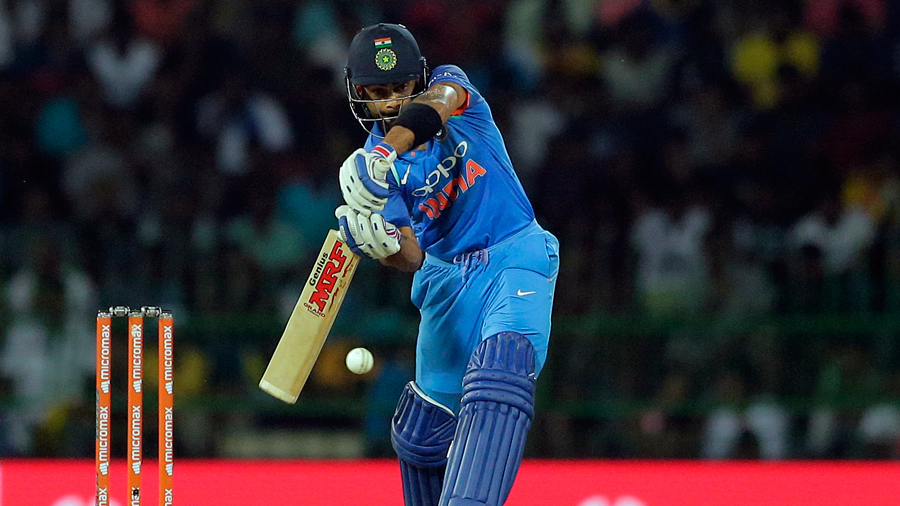 Virat Kohli shapes to play a copybook cover drive