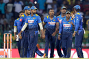 The Sri Lankan players gather around Vishwa Fernando after the dismissal of Rohit Sharma, Sri Lanka v India, 5th ODI, Colombo, September 3, 2017