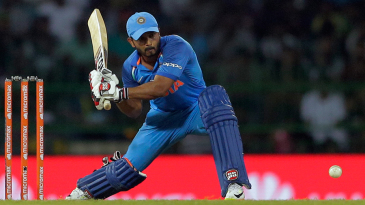 Kedar Jadhav lunges forward to play the slog sweep