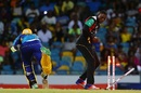 Sheldon Cottrell breaks the stumps to run out Damien Jacobs, Barbados Tridents v St Kitts and Nevis Patriots, CPL 2017, Bridgetown, September 3, 2017